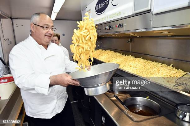 Man tosses fries during a pop-up event organised by the Belgian federal authorities to present a campaign giving 99 reasons to visit or invest in...