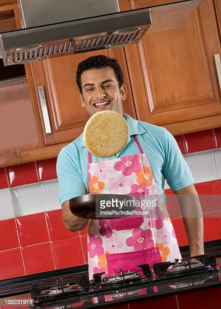 Man tossing a pancake
