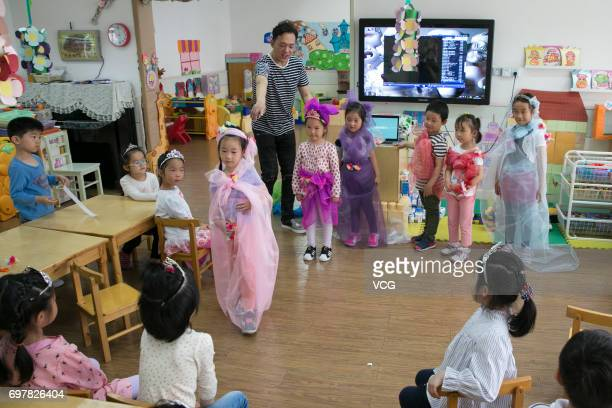 Man Tou and her classmates show their handmade clothes after learning making clothes with Man Tou's stayathome father Qian Xiaofeng on May 23 2017 in...