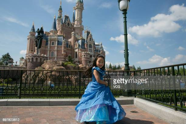 Man Tou wearing Princess Cinderella's dress made by her stayathome father plays at Shanghai Disney Resort on May 21 2017 in Shanghai China Stayathome...