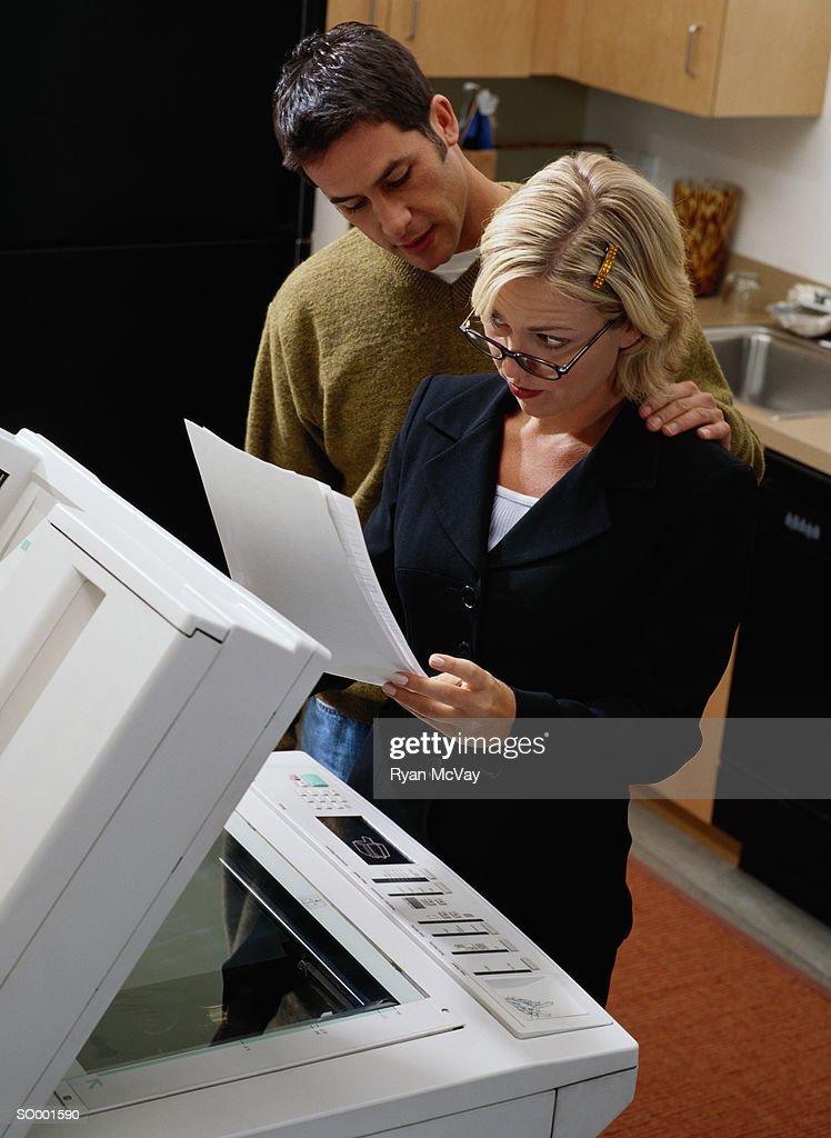 Man Touching a Businesswoman's Shoulder : Stock Photo
