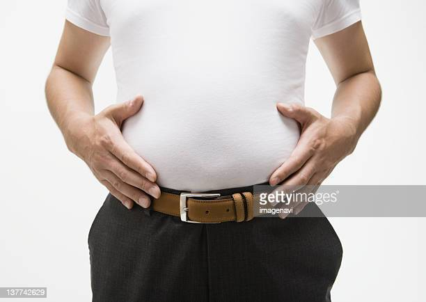 Man touching his belly