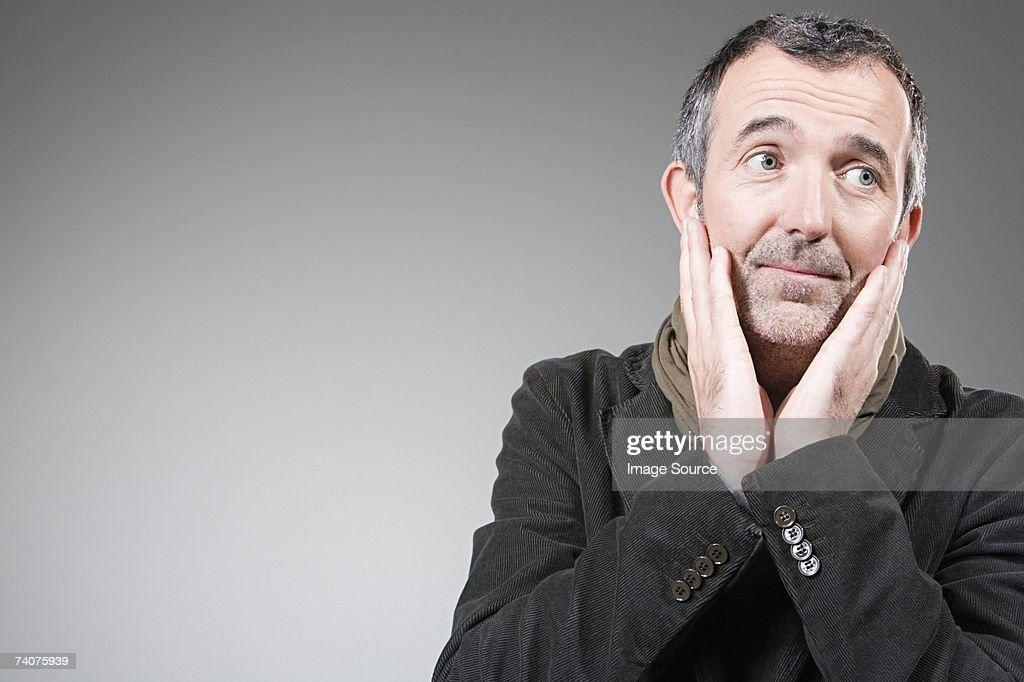 Man touching his face : Stock Photo
