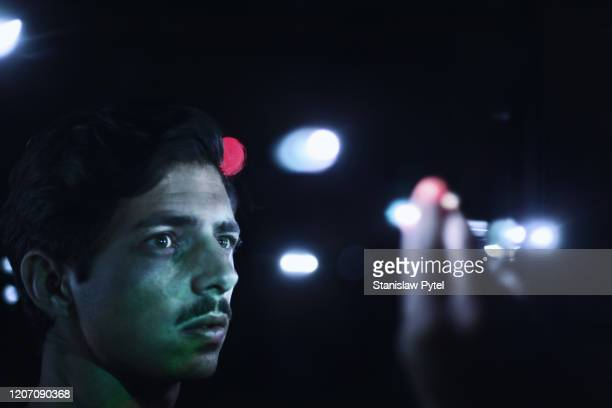 man touching light in darkness - focus on background stock pictures, royalty-free photos & images