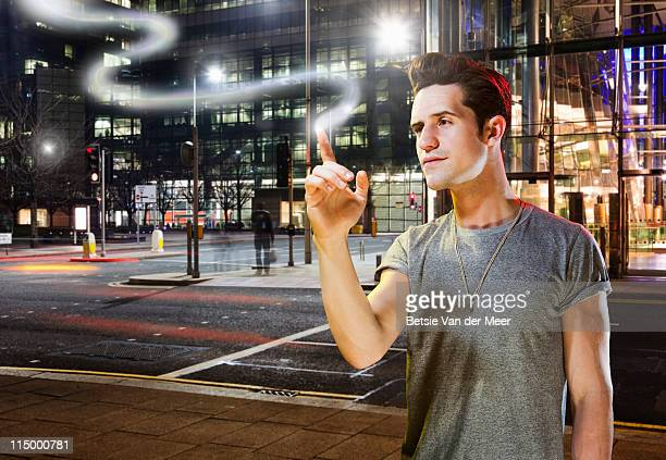 Man touching lightbeam.