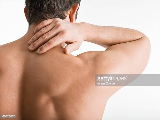 man touching neck - hombre desnudo fondo blanco fotografías e imágenes de stock