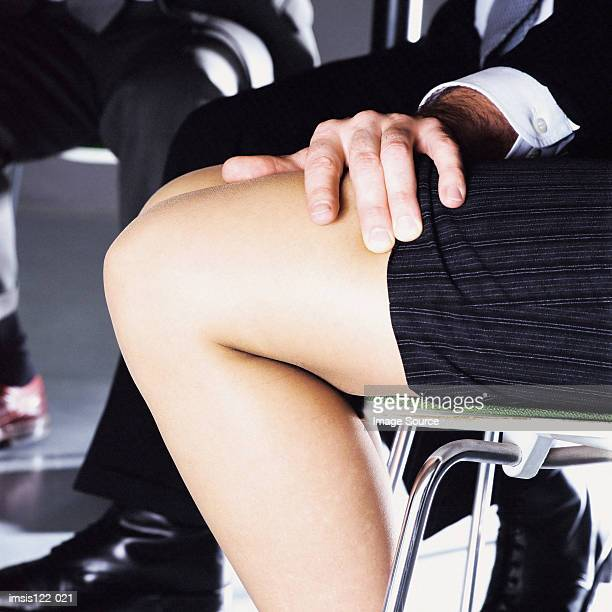 Man touching the legs of a woman
