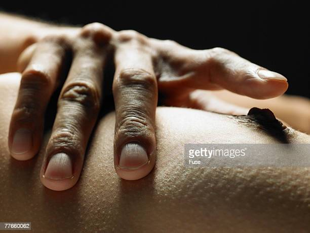 Man Touching Woman's Breast