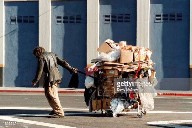 A man tows his cart down the street on Skid Row December 11 2000 in Los Angeles CA