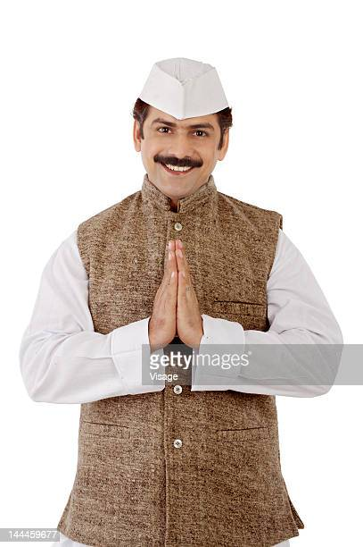 man traditionally dressed doing a traditional hand gesture - politician stock pictures, royalty-free photos & images