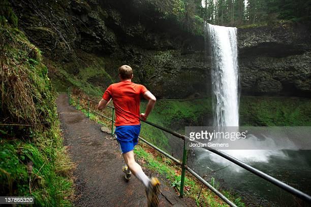 A man trail running.