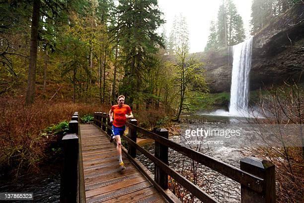 a man trail running. - eugene oregon stock pictures, royalty-free photos & images