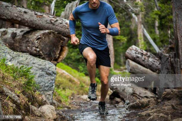 man trail runs through forest in indian peaks wilderness, colorado - cross country running stock pictures, royalty-free photos & images