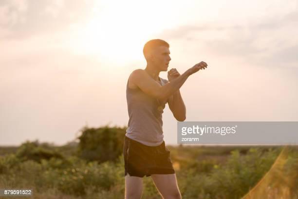 Man trainging shadow boxing outdoors
