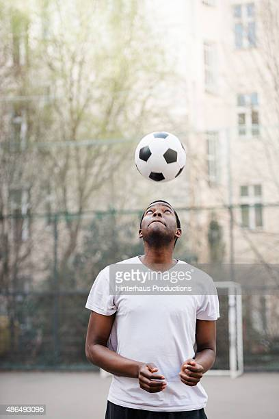 man training header - heading the ball stock pictures, royalty-free photos & images