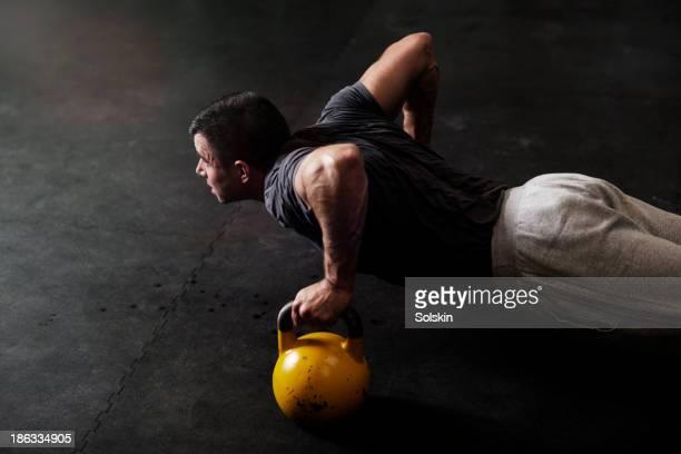 man training in gym gym - kugelhantel stock-fotos und bilder