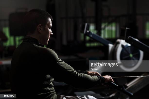 Man training, using a rowing machine