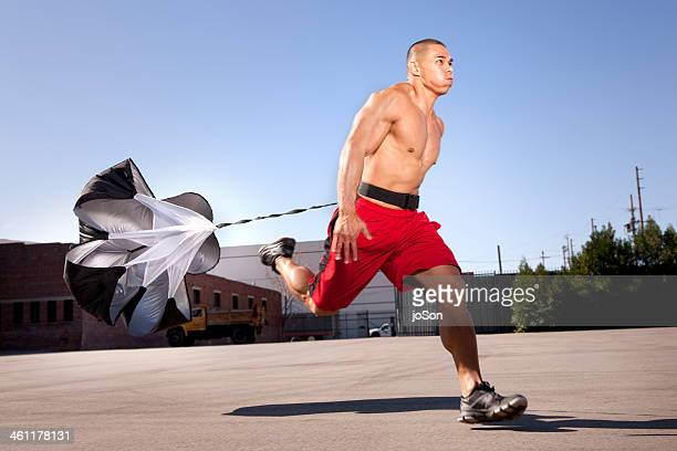 Man training with resistance parachute