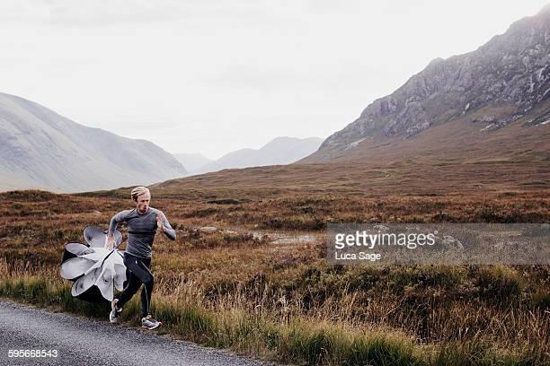 Man training with speed chute Scottish highlands