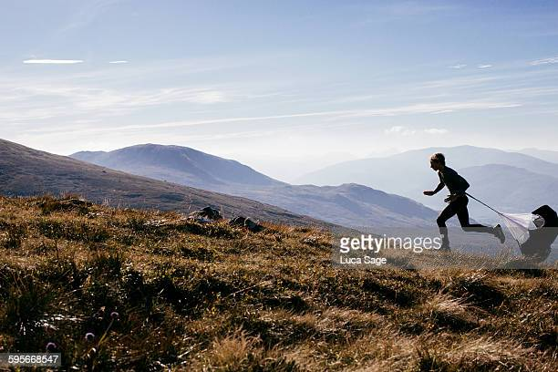 Man training with speed chute Scottish highlands