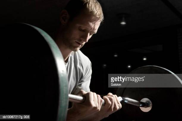 Man training with weights in fitness center