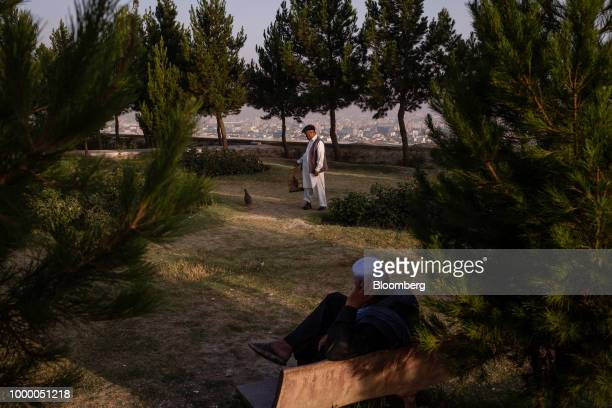 A man trains a bird at the top of Bibi Mahru Hill in Kabul Afghanistan on Sunday July 15 2018 US President Donald last year said 16000 US troops...