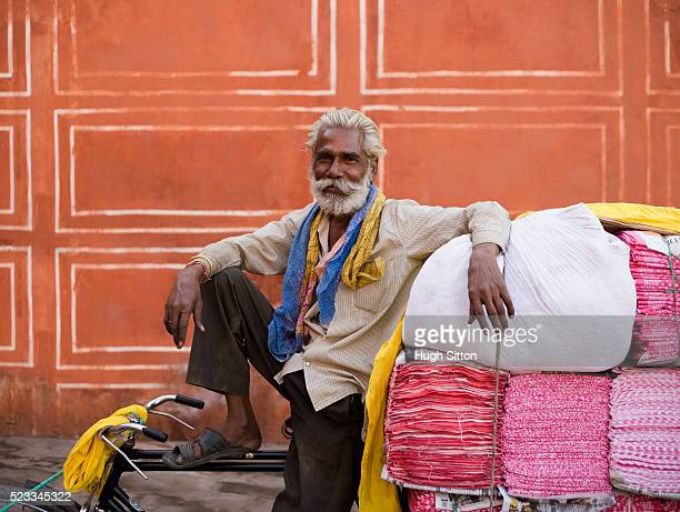 man transporting fabric with bicycle - hugh sitton india stock pictures, royalty-free photos & images