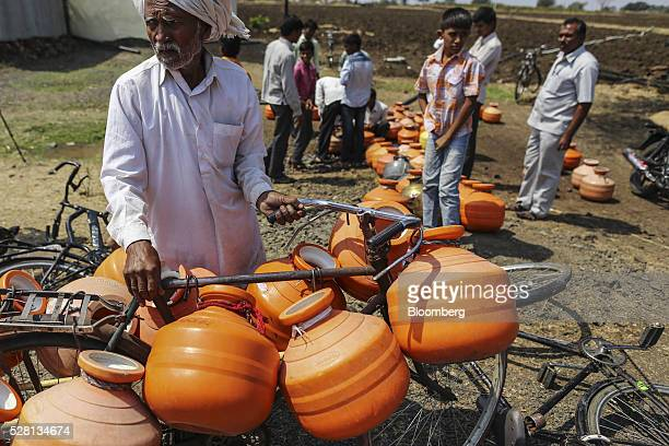 A man transports empty containers on his bike to a groundwater source in Latur Maharashtra India on Saturday April 16 2016 Hundreds of millions of...