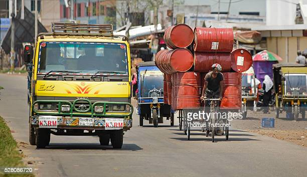 A man transports oil barrels with his rickshaw on April 11 2016 in Khulna Bangladesh