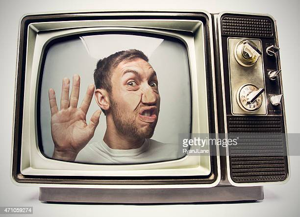 man trapped in retro television - trapped stock pictures, royalty-free photos & images