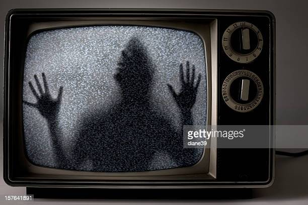 man trapped inside television