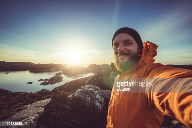 man travel adventures: mountain hiking in norway - selfie stock pictures, royalty-free photos & images