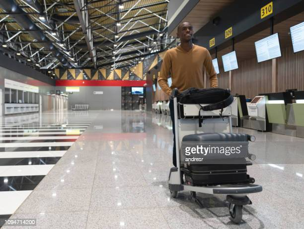 Man traveling by plane and carrying bags at the airport