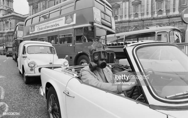 A man travelling to work wearing a gas mask due to exhaust pollution London UK 16th April 1971