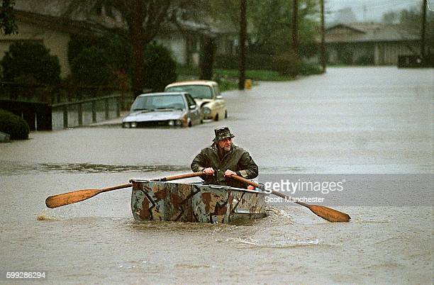 A man travels round town by boat
