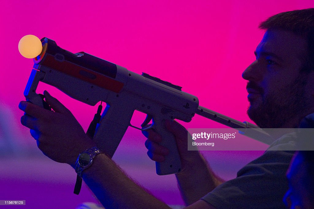 A man tries a Sony Corp. PlayStation Move rifle at the Electronic Entertainment Expo (E3) in Los Angeles, California, U.S., on Wednesday, June 8, 2011. In April, Tokyo-based Sony disclosed that its entertainment networks had been targeted by hackers in incidents that exposed account information on 100 million customers and led the company to temporarily close its PlayStation Network. Photographer: Jonathan Alcorn/Bloomberg via Getty Images