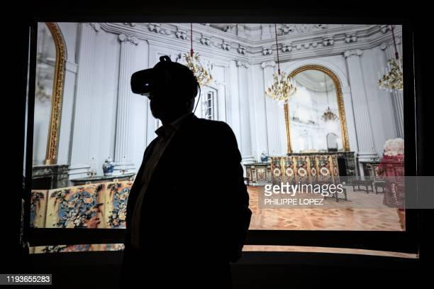A man tries a virtual reality visit of the Marly castle during a visit of the museum of the royal domain of Marly in MarlyleRoi on January 14 2020...