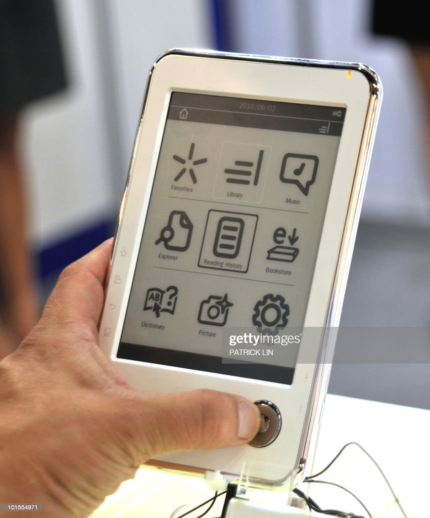 A man tries an e-book on display at a booth of the Taipei World Trade Centre, where Computex Taipei, Asia's biggest information technology trade fair is being staged on June 2, 2010. More than 1,700 exhibitors are taking part in the five-day trade show, featuring 4,861 booths and expected to greet around 120,000 visitors, including 35,000 international buyers, organisers say. They expect the fair to generate around 20 billion US dollars in business.