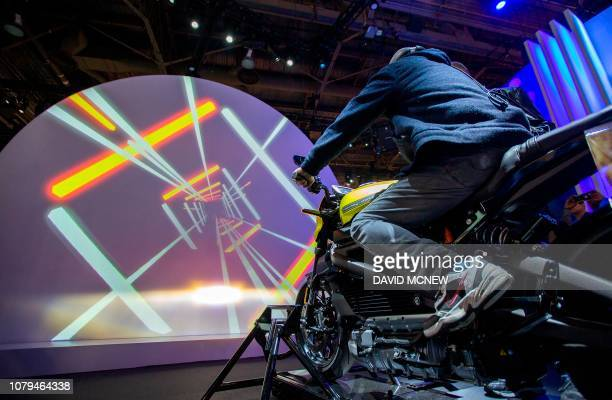 A man tries out a HarleyDavidson LiveWire electric motorcycle at the Panasonic exhibit during CES 2019 in Las Vegas Nevada on January 8 2019