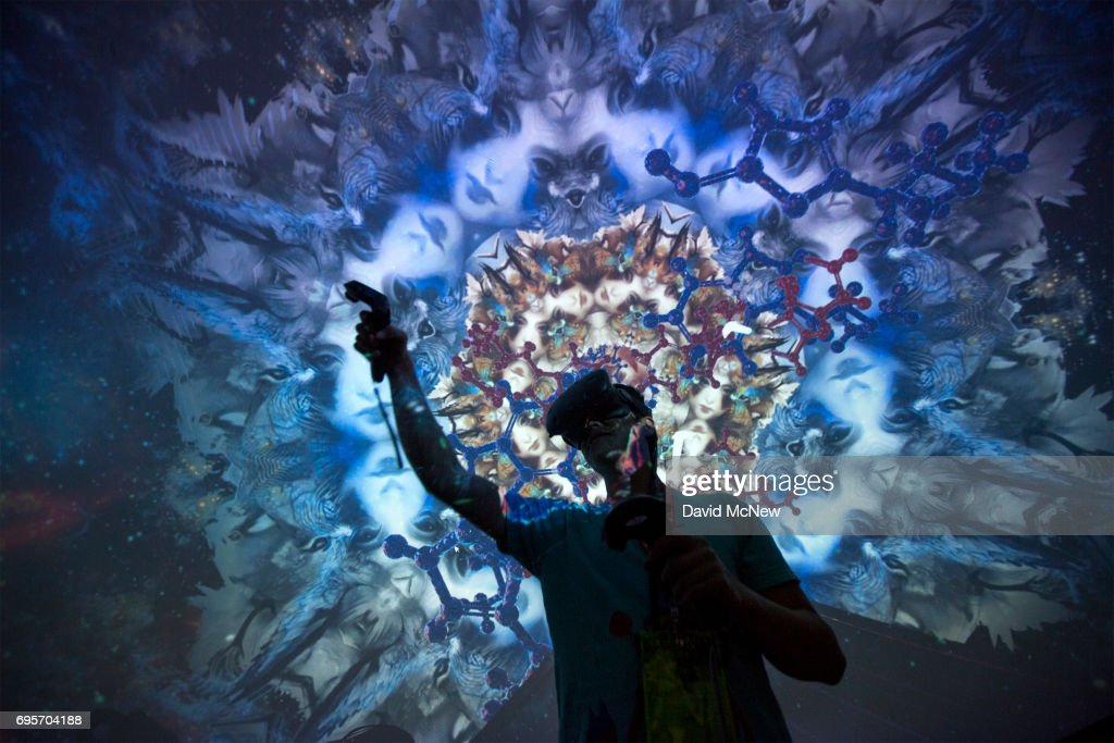 A man tries out a Virtual Reality game inside a Fulldome.pro 360-degree projection dome on opening day of the Electronic Entertainment Expo (E3) at the Los Angeles Convention Center on June 13, 2017 in Los Angeles, California. The computer and video game trade show draws an international crowd of industry members and fans, and runs June 14 through 16.