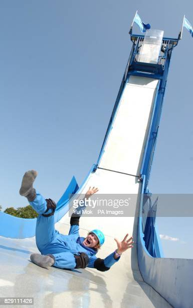 A man tries out the Airwaves Dropzone ride the world's first trapdoor mobile slide at the Urban Games being held at Clapham Common south London
