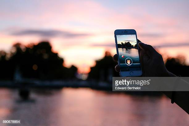 A man tries to catch a Piafabec character while playing Nintendo Co's Pokemon Go augmentedreality game At Jardin des Tuileries on August 17 2016 in...