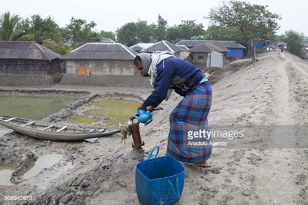 Man tries to collect drinkable water after the rise of sealevel as Department of Environment's study conducted between April 2013 and Oct 2015 which...