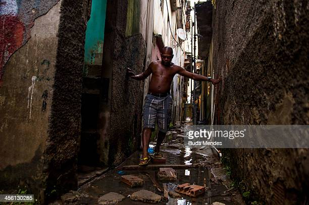 A man tries to walk in the alleys of Manguinhos shantytown complex following heavy rains that hit the spot which this year received the visit of Pope...