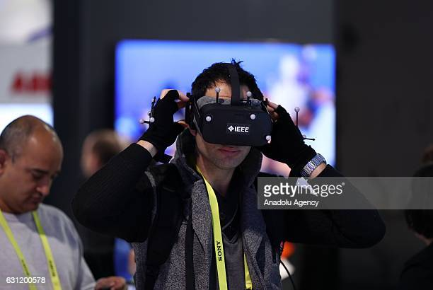 A man tries virtual reality and wearable technology product during the 2017 Consumer Electronics Show in Las Vegas Nevada USA on January 08 2017