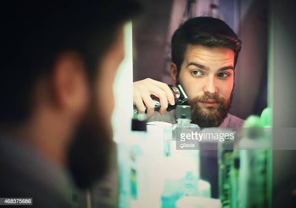 Man trimming beard.