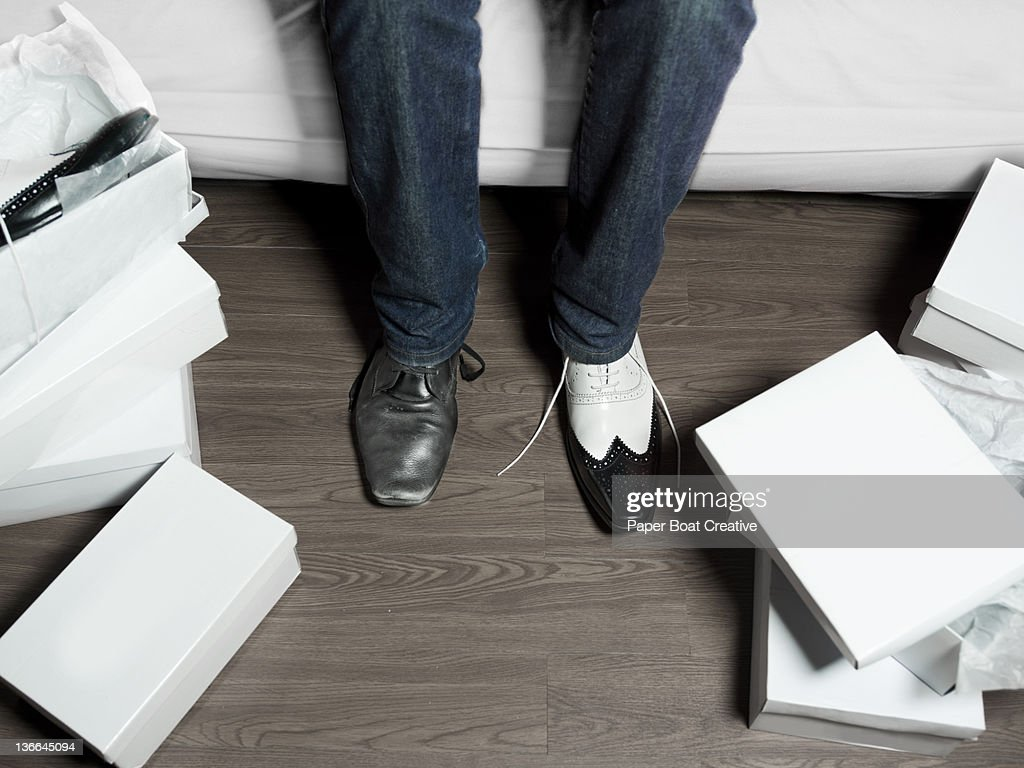 man trying on a new pair of smart shoes : Stock Photo