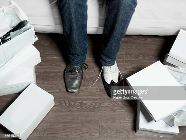 man trying on a new pair of smart shoes