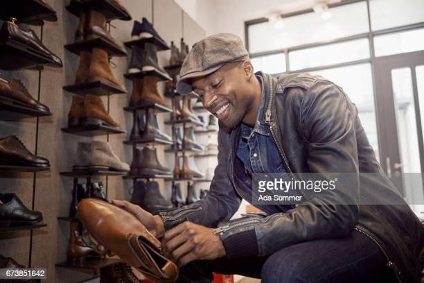 man trying on shoes in a store
