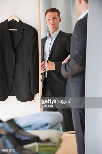 Man trying on suit